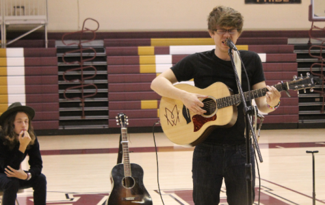 Former student performs songs for student body
