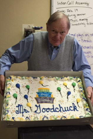 Mr. Goodchuck holds his birthday cake.