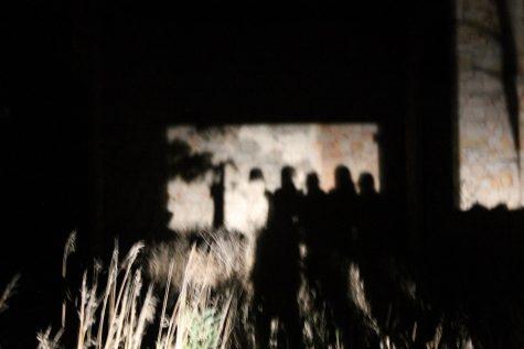 The shadows of each newspaper member against the church walls.