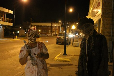 """Two members from the """"Haunted Tours"""" downtown."""