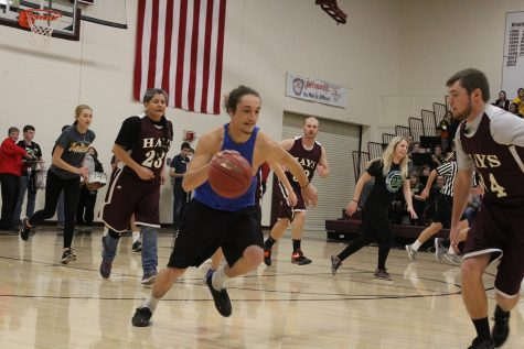 Teachers defeat students during pep assembly basketball scrimmage