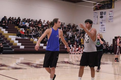 Junior Nick Silva and senior Michael Reyes walk off the court after being defeated by the teachers.