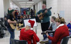 Guitar club boosts holiday cheer with hallway carols