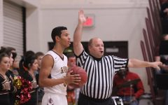 Boys basketball falls in first round of Colby tournament