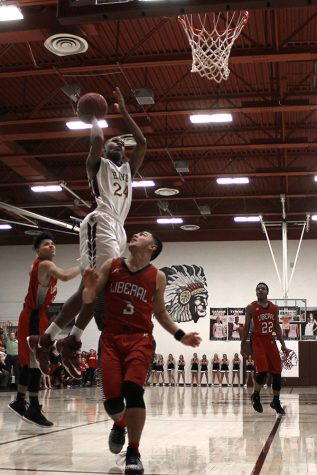 Boys basketball loses to Abilene Cowboys