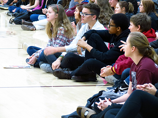 Students look on as it's announced that Hays High is the ACT College and Career Transition Exemplar during an assembly on April 5.