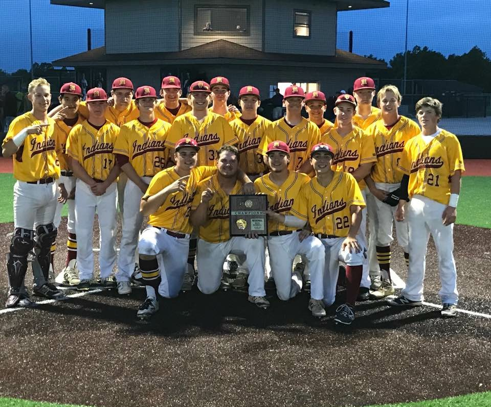 The+Indian+baseball+team+poses+with+their+regional+championship+plaque.