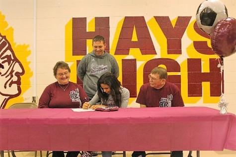 Senior Lieacha Cook signs to Bethel College