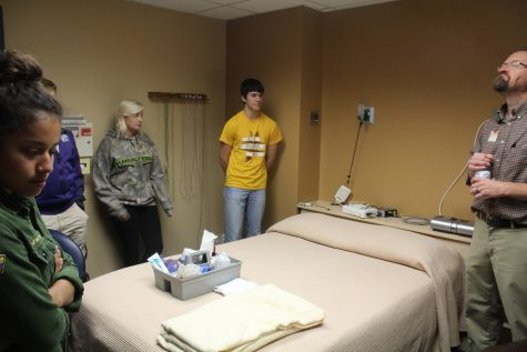 Students stand in the sleep analysis room at the Sleep Center.