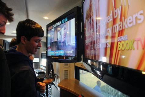 Junior Reese Lovell views the screens in the C-SPAN bus.