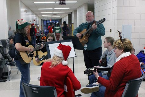 Guitar club boosts holiday cheer with hallway carols
