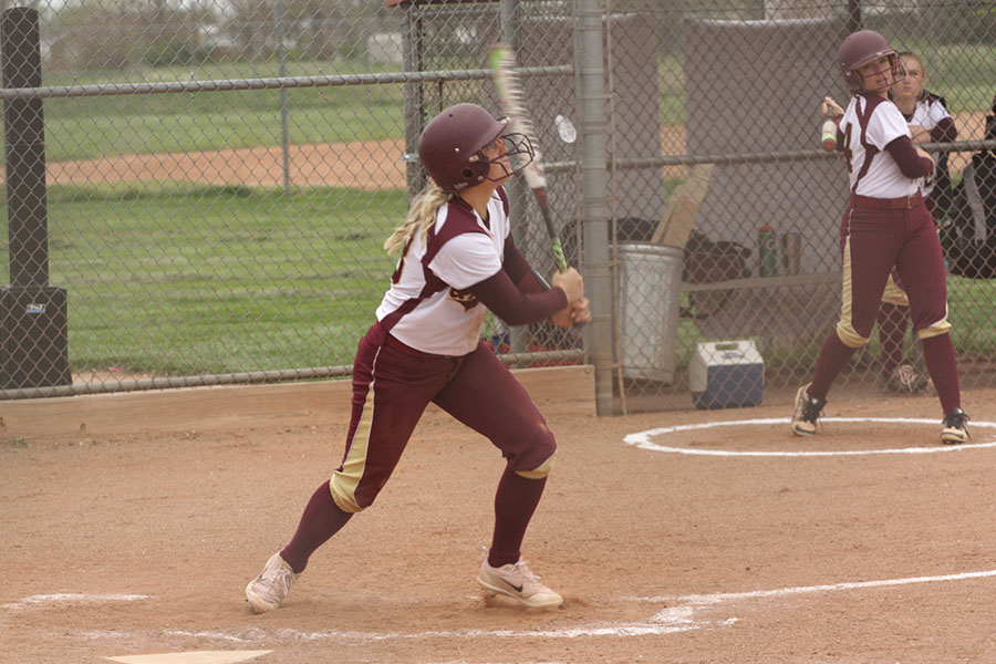 Freshman+Macee+Altman+hits+off+the+Garden+City+pitcher+in+the+home+game+against+the+Buffaloes+on+April+25.