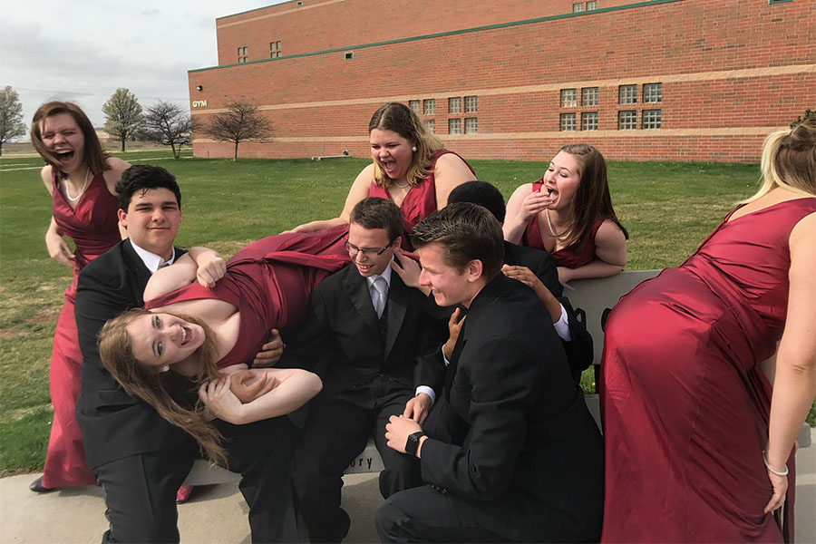 Senior Chamber Singers take a picture before singing for the judges. The chamber singers received a one from all of the judges.