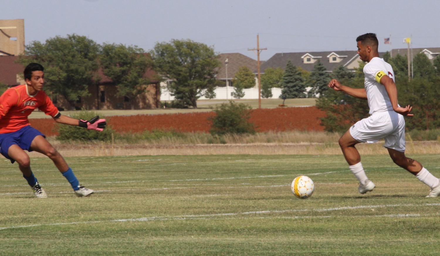 Senior Ethan Nunnery takes on Dodge City's goalkeeper one on one in a recent home game.