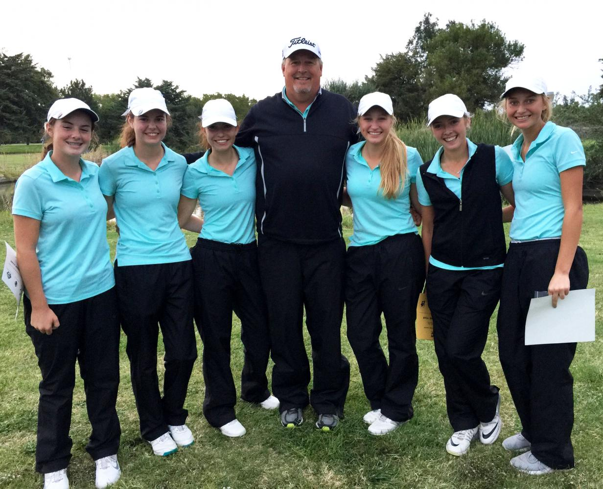 The Lady Indian golf team won the WAC title in the Great Bend Invitational on Oct. 3. Pictured left to right: freshman Sophia Garrison, junior Emily McGuire, junior Molly Eikenberry, Coach Mark Watts, junior Brittani Park, senior Karee Dinkel, junior Emily George