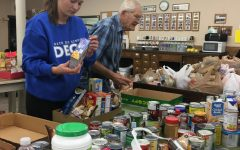 DECA chapter collects cans for Community Assistance Center