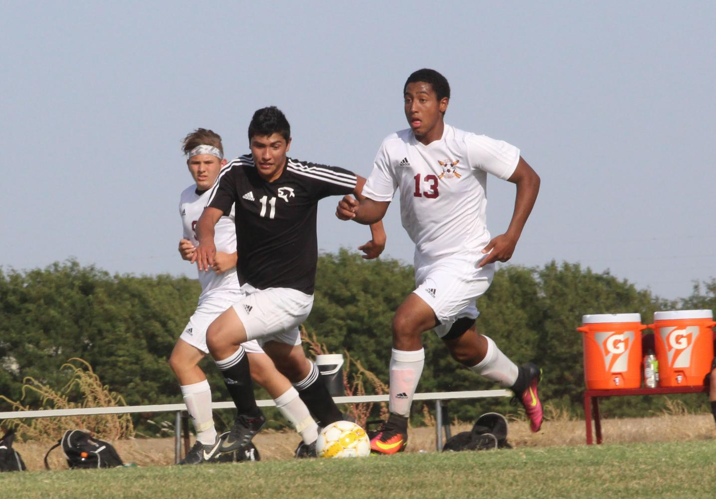 Junior Trey McCrae dribbles up field at the Great Bend defense in a recent home match up.
