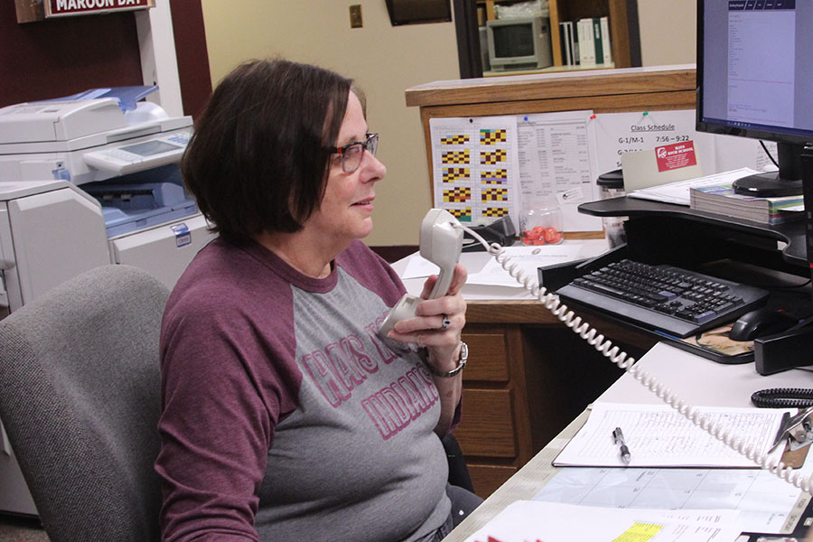 Sue Rouse works in the office as a receptionist, answering calls, making announcements and checking in visitors.