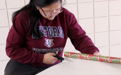 National Honor Society wraps gifts for Holiday Help Project