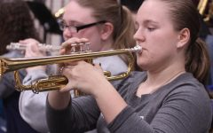 Pep band students contribute to home basketball games