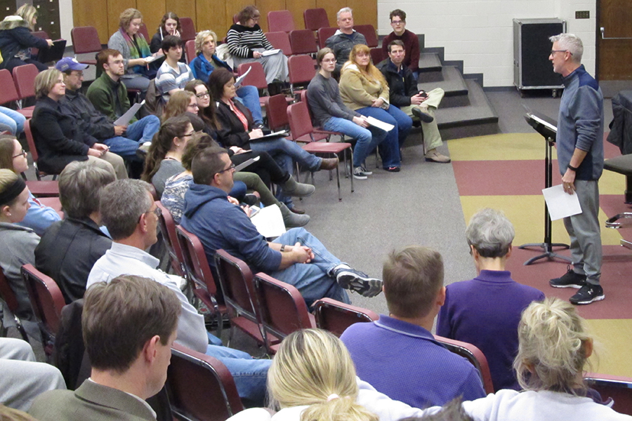 Instructor Johnny Matlock holds his annual Dinner Show meeting with the parents of students in Chamber Singers. The meeting is normally held earlier in January but had to be moved back on account of a new development.