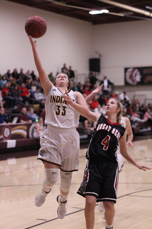 Sophomore Brooke Denning goes up for a shot in a recent game against Great Bend. On Feb 16, the Lady Indians basketball team lost to Garden City.