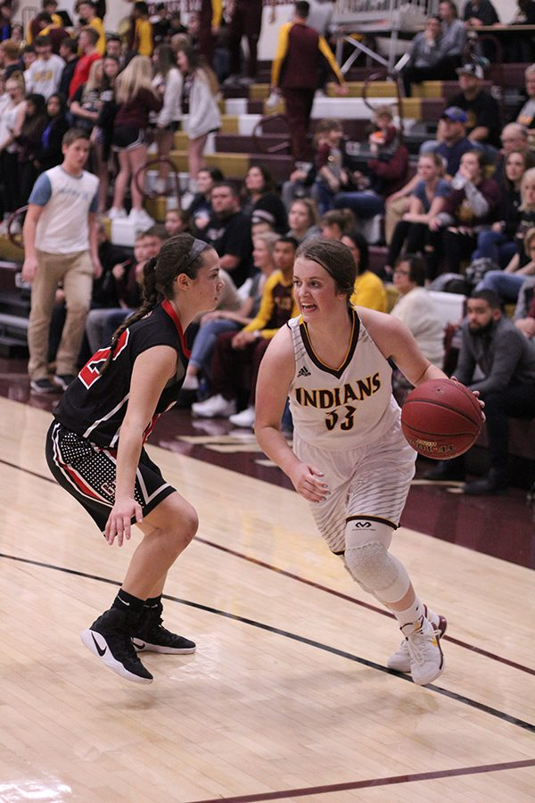 Sophomore+Brooke+Denning+drives+into+the+lane+for+a+shot+in+a+recent+game+against+the+Great+Bend+Panthers.+On+Feb+13%2C+the+Indians+pulled+off+a+win+over+the+Abilene+Cowgirls%2C+57-37.