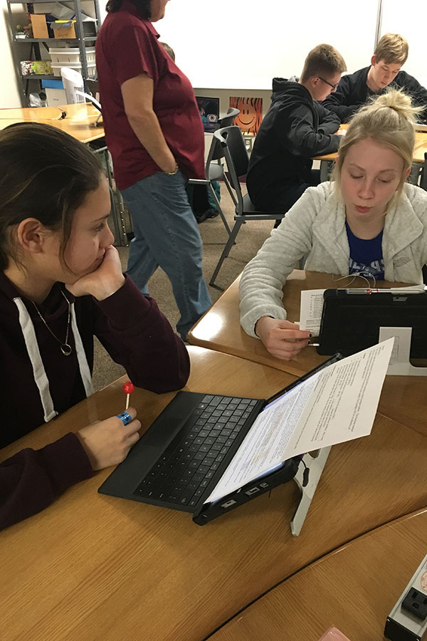 Sophomores Dellilah Herrera and Ashton Tabor preparing for the student led conferences  on Feb. 23
