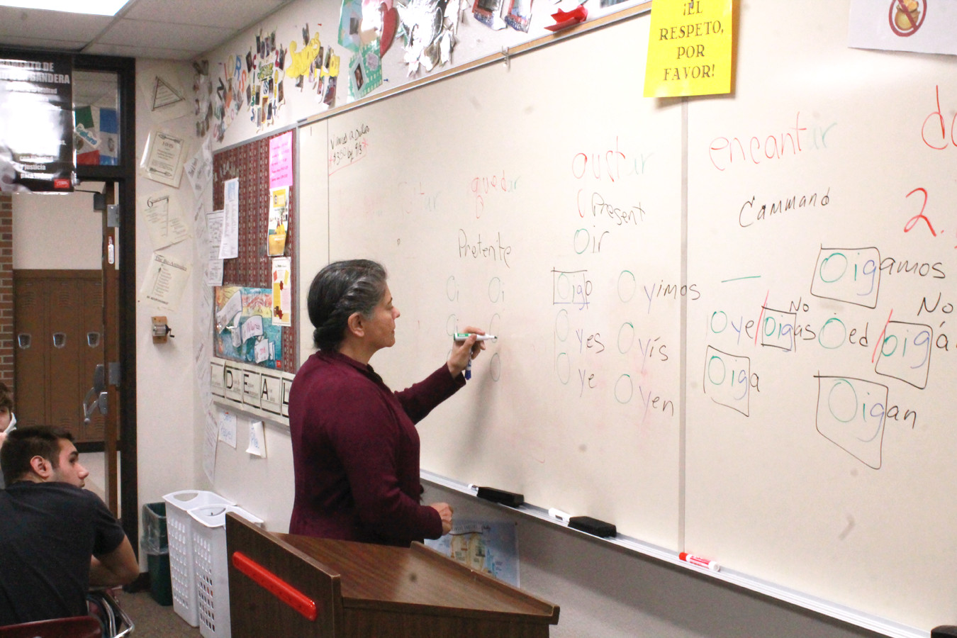 Instructor Gallegos-Haynes teaches students verb conjugation.