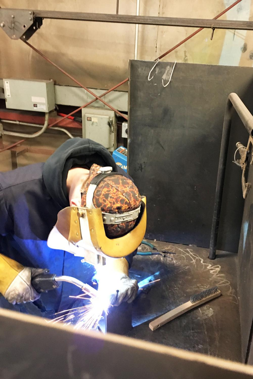 Junior Matthew Fross works on the welding portion of  the competition.