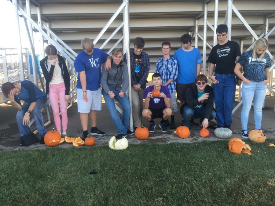 Physics students pose with their pumpkins after testing their acceleration due to gravity.