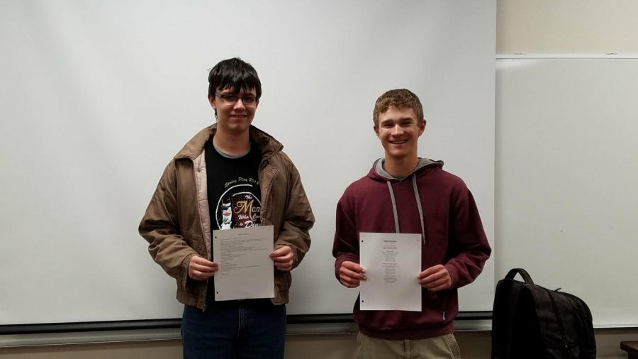 Freshman Andrew Duke and sophomore Levi Hickert stand with their winning poems.