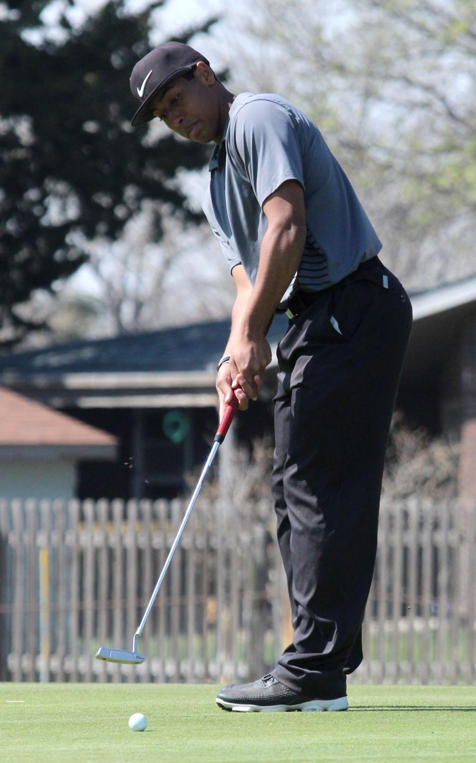 Junior Trey McCrae squares up on the green in a recent tournament at home. On May 14, McCrae won his sixth tournament of the season.
