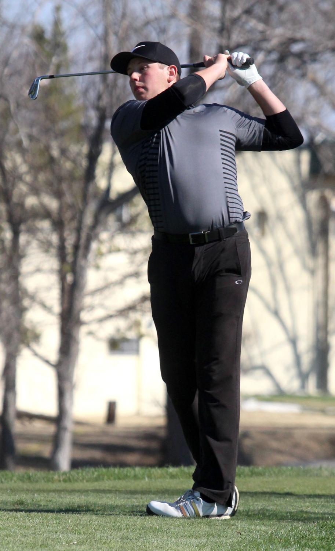 Senior Peyton Kieffer swings at the recent Smoky Hill tournament. Kieffer was named 2nd team all WAC.