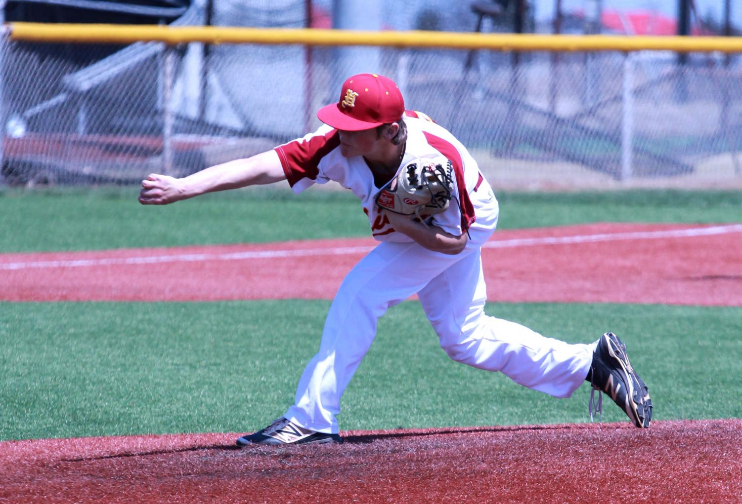 Junior Willie Sennett pitches in a recent home game.